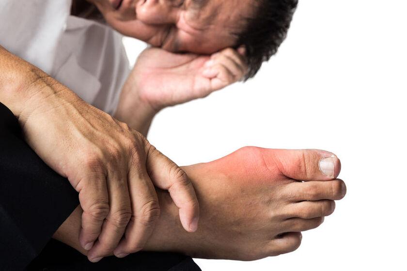 Osoba z bólem stopy