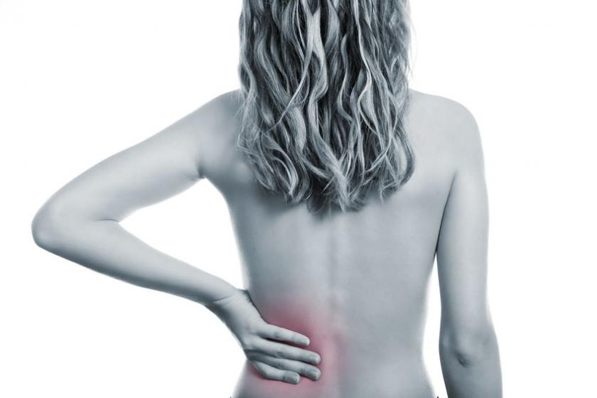 Kobieta w ciąży cierpiąca na bóle krzyżowe